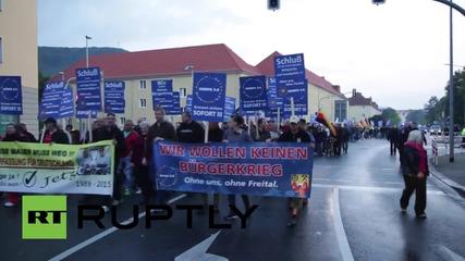 Германия: Анти-емиграционна организация марширува през Фрайтал срещу бежанската политиката на Меркел
