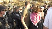 East Jerusalem: Israeli forces use water cannons against protesters in Sheikh Jarrah