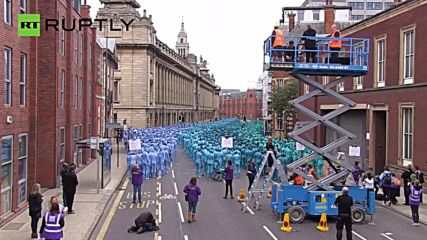 Thousands Paint Their Naked Bodies Blue for Unusual Art Installation