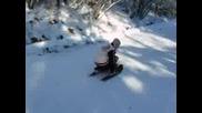 Спускане със снегокат