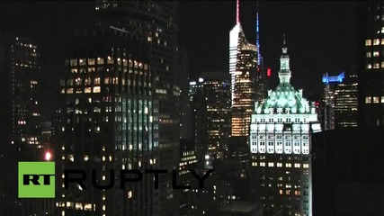 USA: Freedom Tower lit in red, white and blue in solidarity with France