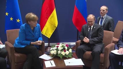 France: Putin and Merkel talk on sidelines of COP21 in Paris