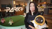 Cafe in Tokyo robot park lets guests share a drink and a byte to eat with AI