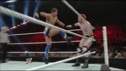 Jumping Corner Clothesline followed by Double Axe Handle - The Miz