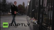 Ukraine: Plane crash mourners place flowers outside Russian embassy in Kiev