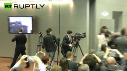 FEMEN Activist Jumps On Table During Draghi's ECB Presser