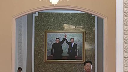 North Korea: Kim and Moon all smiles as giant portrait of two revealed