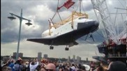 "Space Shuttle Enterprise Makes Final Landing ""docks""at New York City's Intrepid Museum."