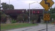Влак минава по мост в далечината