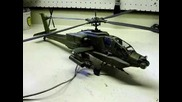Ah-64 Apache helicopter model customized with lights and operating main rotor