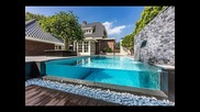 Dream Backyard Garden With Amazing Glass Swimming Pool