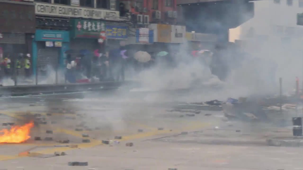 Hong Kong: Tear gas flies, protesters detained as they flee Polytechnic University