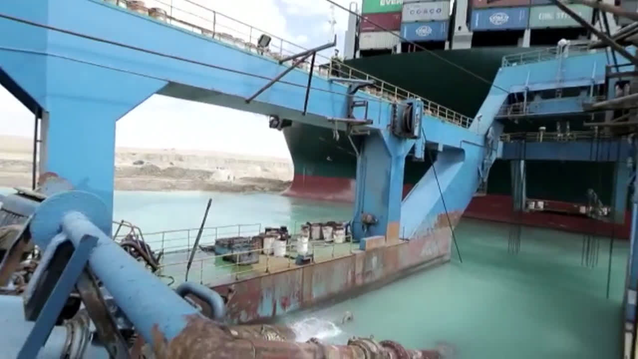 Egypt: Suez Canal chief visits blockage site as efforts to refloat cargo ship continue