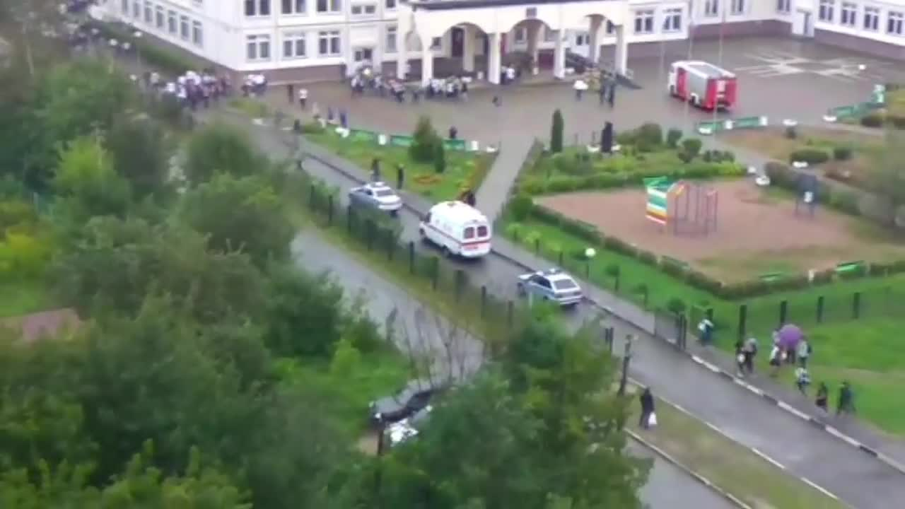 Russia: Teenager flanked by police following frenzied attack on teacher in Ivanteyevka