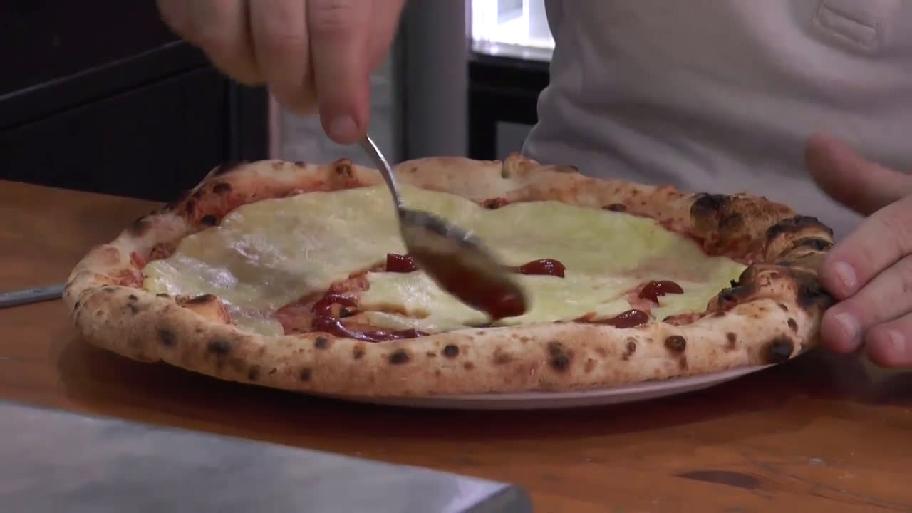 Italian chef pays tribute to Maradona with pizza recreating football legend's face