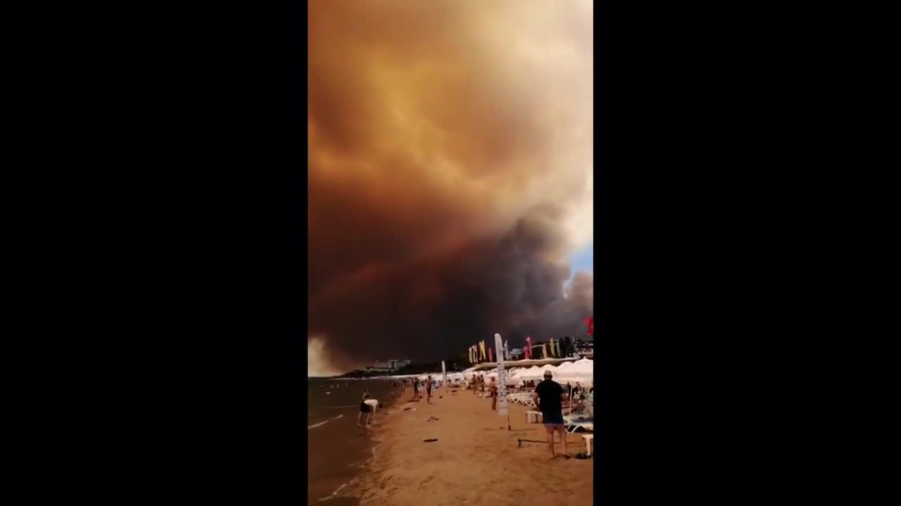 Turkey: Smoke billows over Antalya beach as wildfires force evacuations