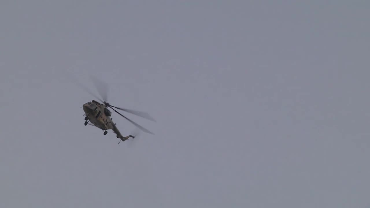 Afghanistan: Planes and helicopters fly over Kabul with shots heard amid evacuation efforts