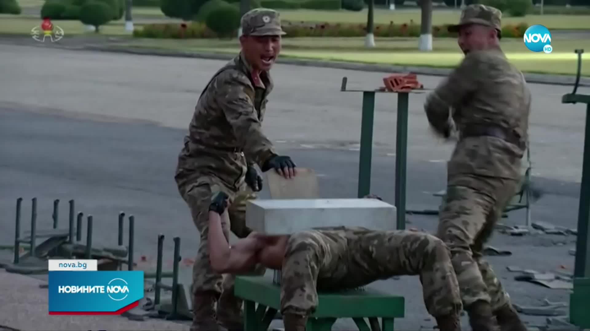 Войници се удрят с чукове и замерят с бойни ножове в КНДР