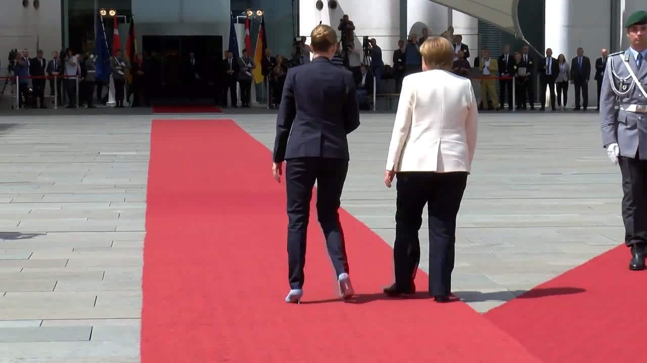 Germany: Merkel and Denmark\'s PM sit at welcoming ceremony in breach of protocol