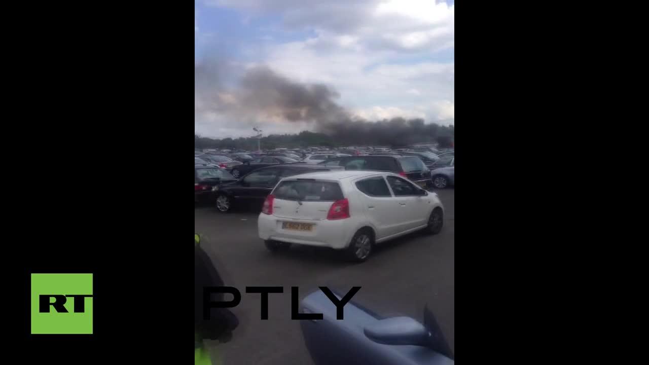 UK: Four dead as plane crashes into car auction site